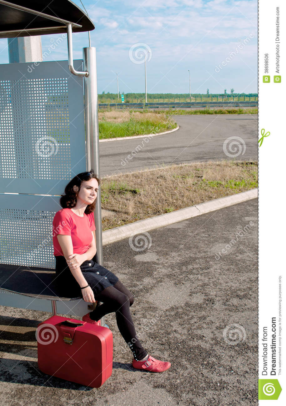 Young woman waiting in a station