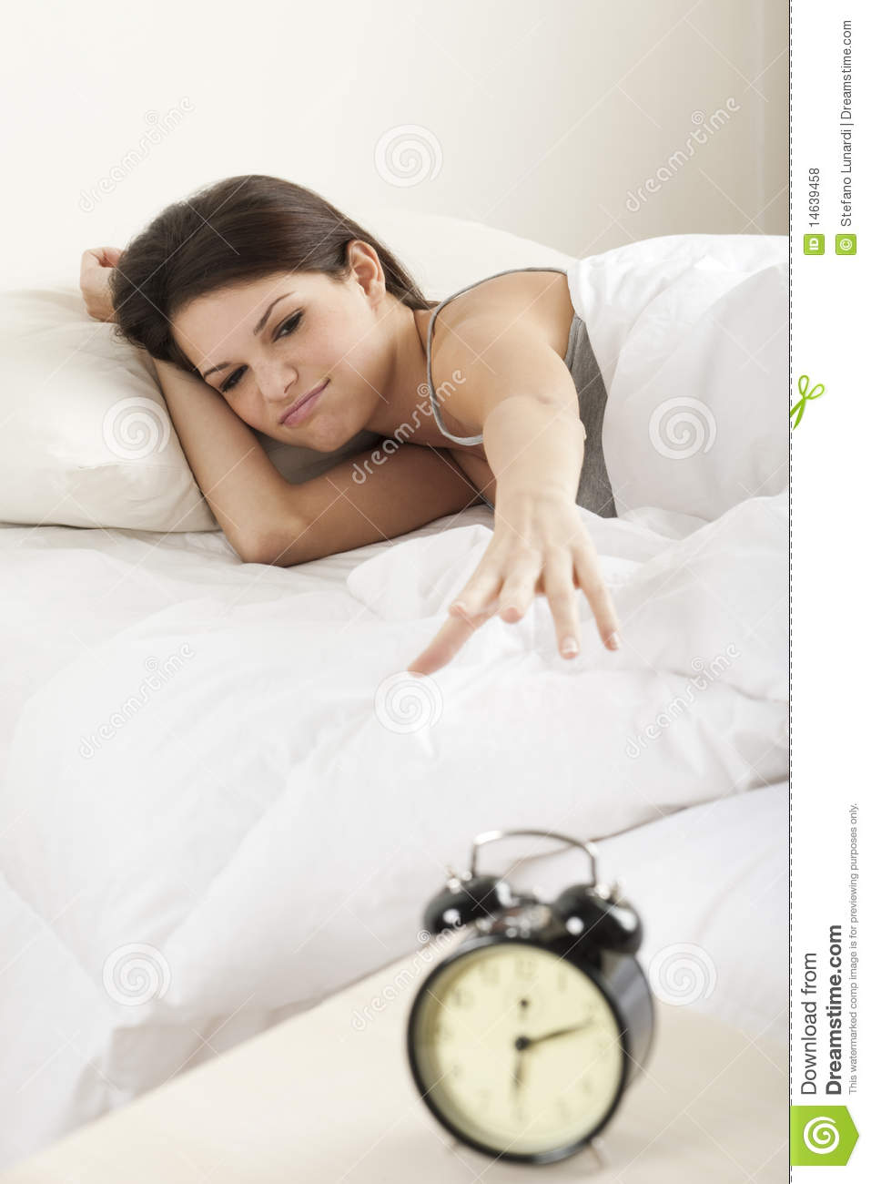 Young Woman Waking Up ...