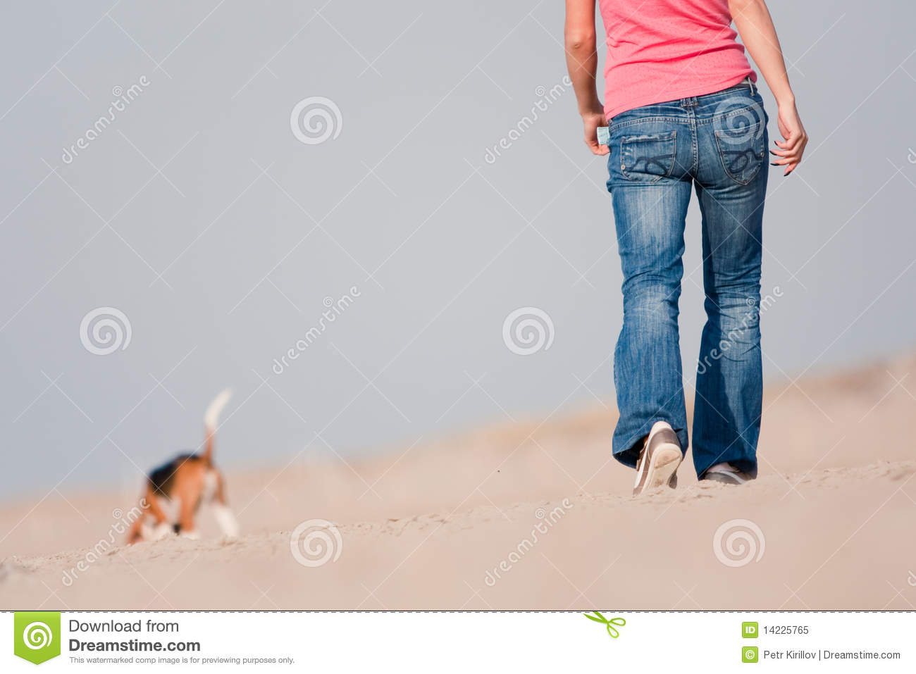 Woman walking on a beach royalty - Beach Dog Walking Woman