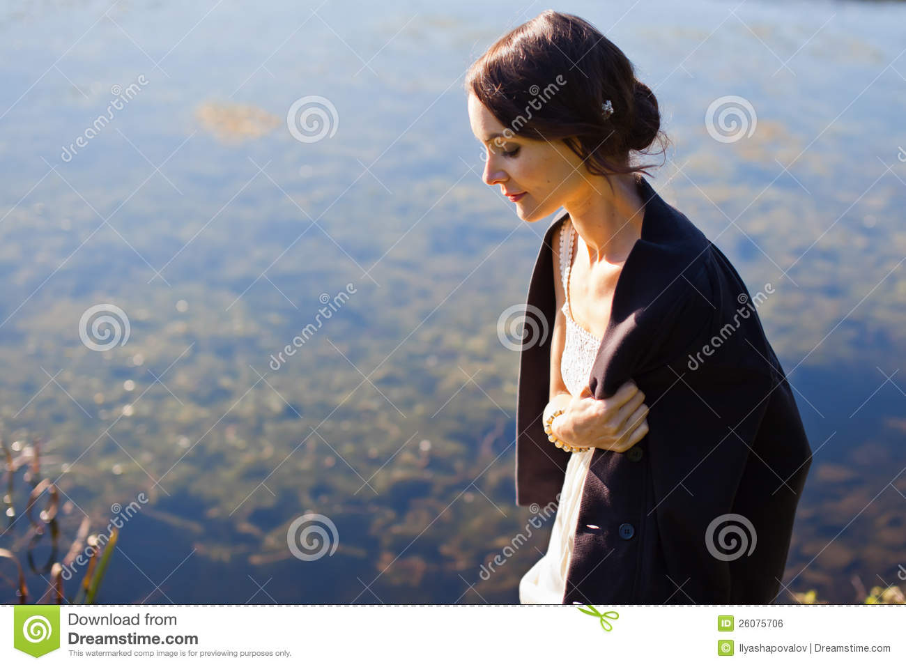 Young woman walking by water