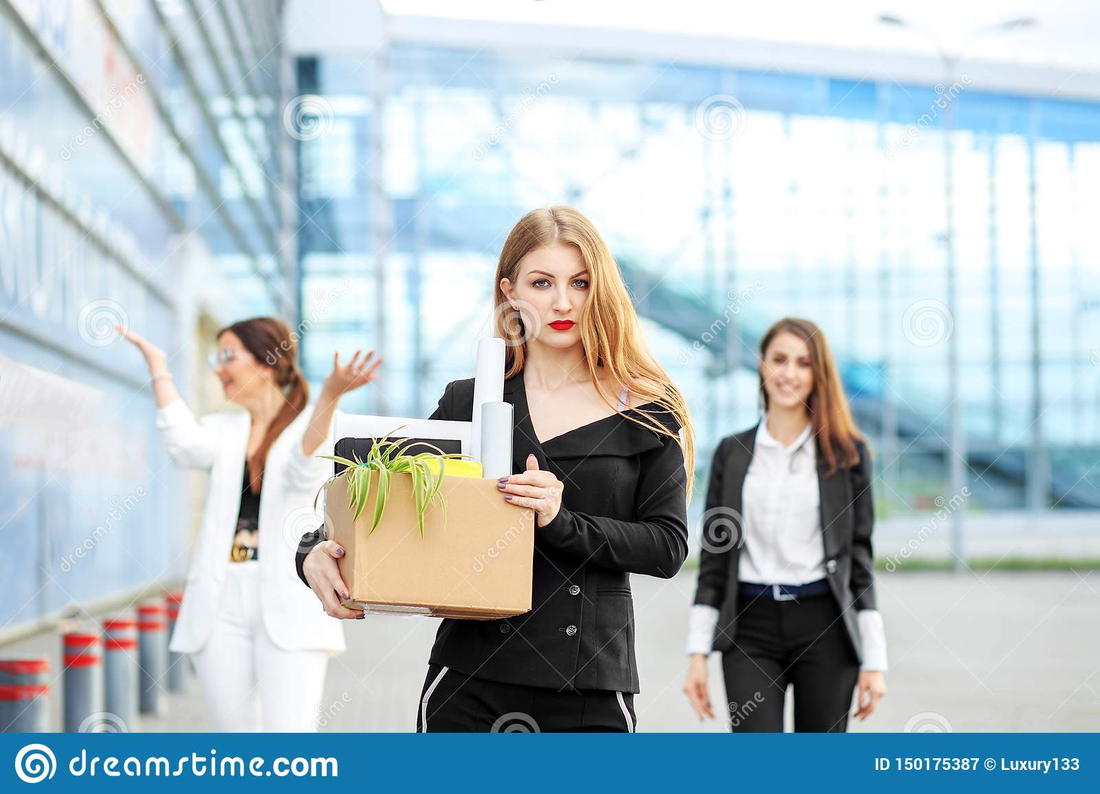 The young woman was fired from the corporation. The end of a career. Concept for business, unemployment, labor exchange and