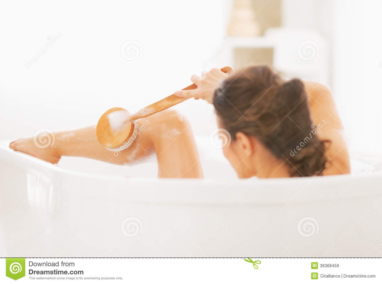 Young Woman Washing In Bathtub Rear View Stock Image Image Of - Best thing to clean bathtub