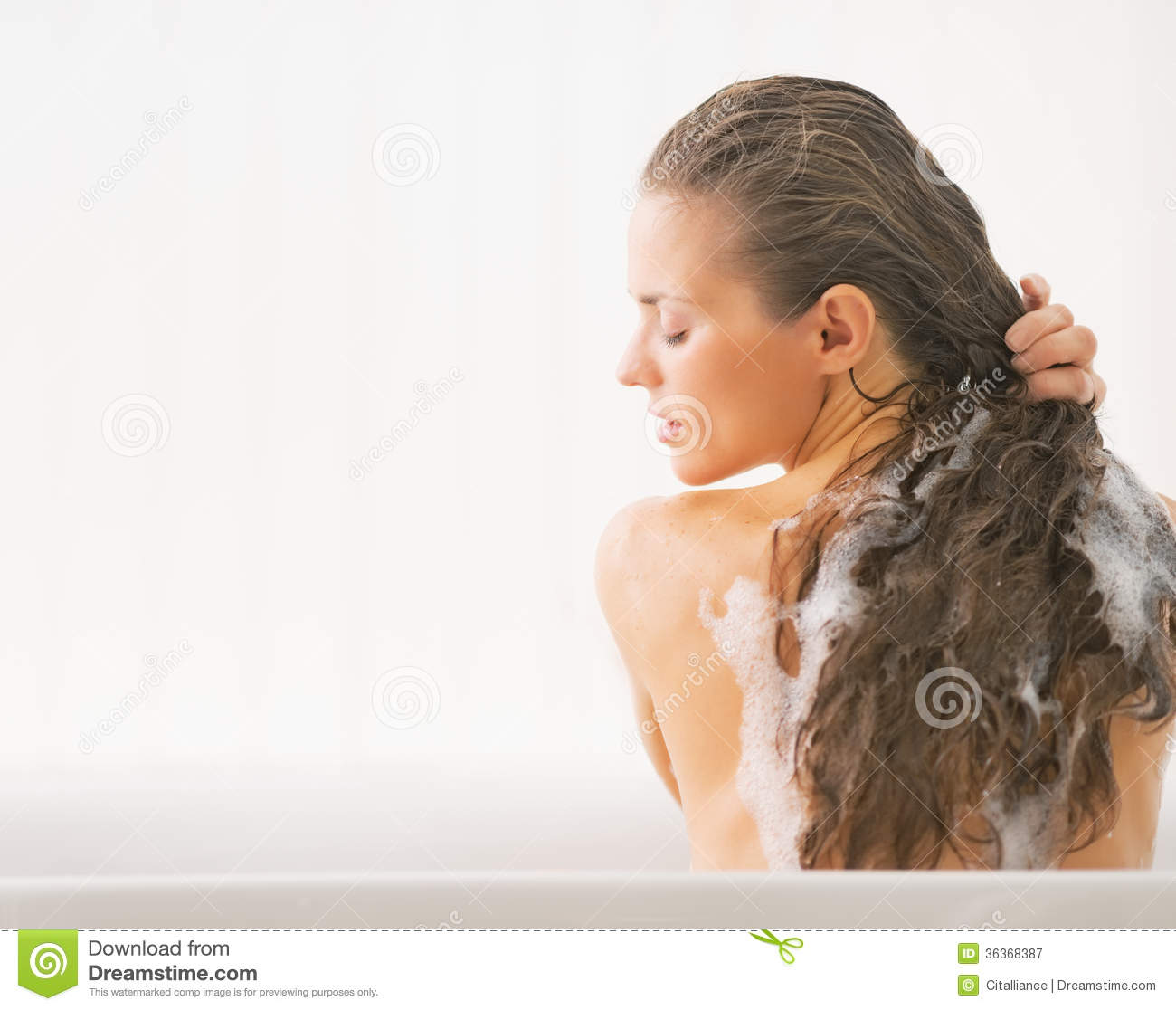 Young Woman Washing Hair In Bathtub Royalty Free Stock Photography ...