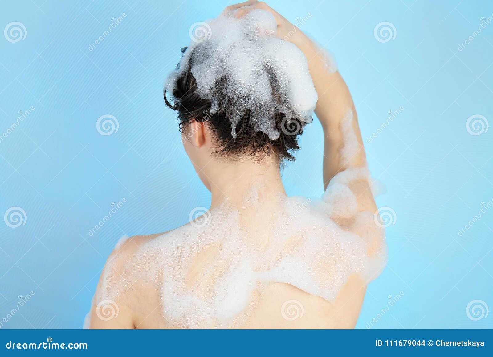 Woman Taking A Long Hot Shower Washing Her Hair Stock