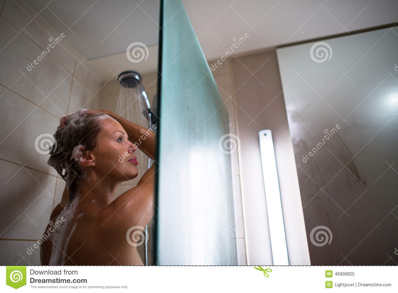 naked woman in the shower in the position
