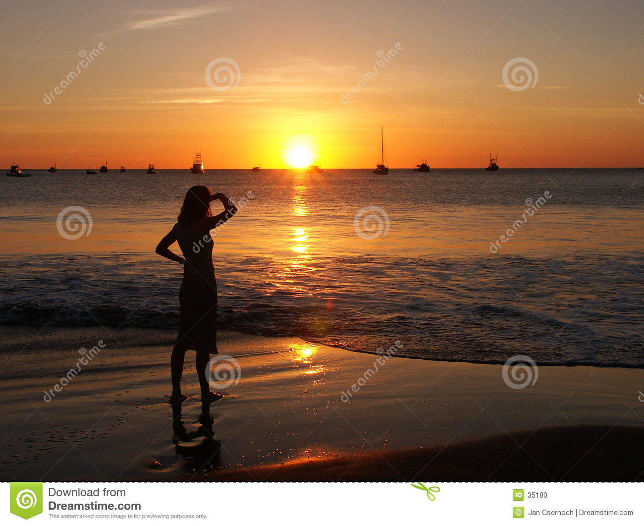 Young woman watching sunset