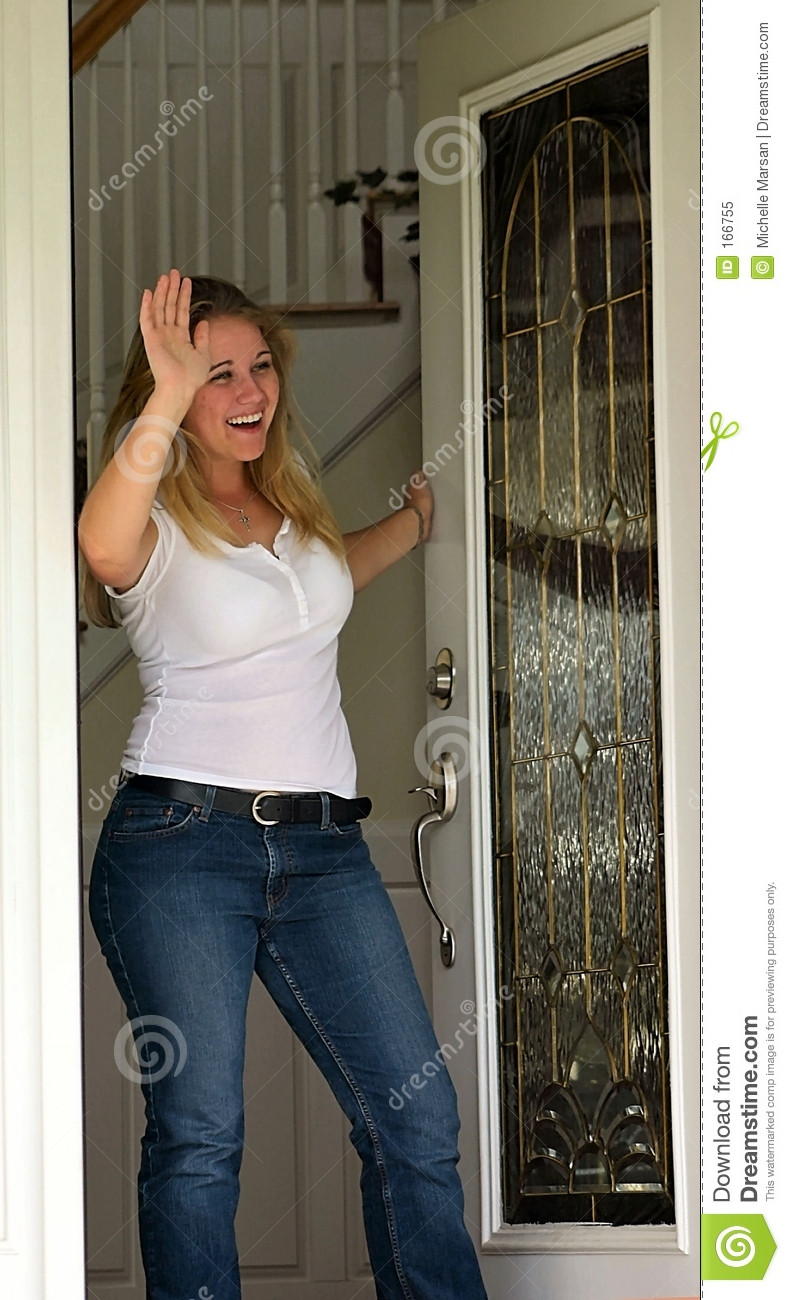 Young woman waving at front door royalty free stock photo for House friend door