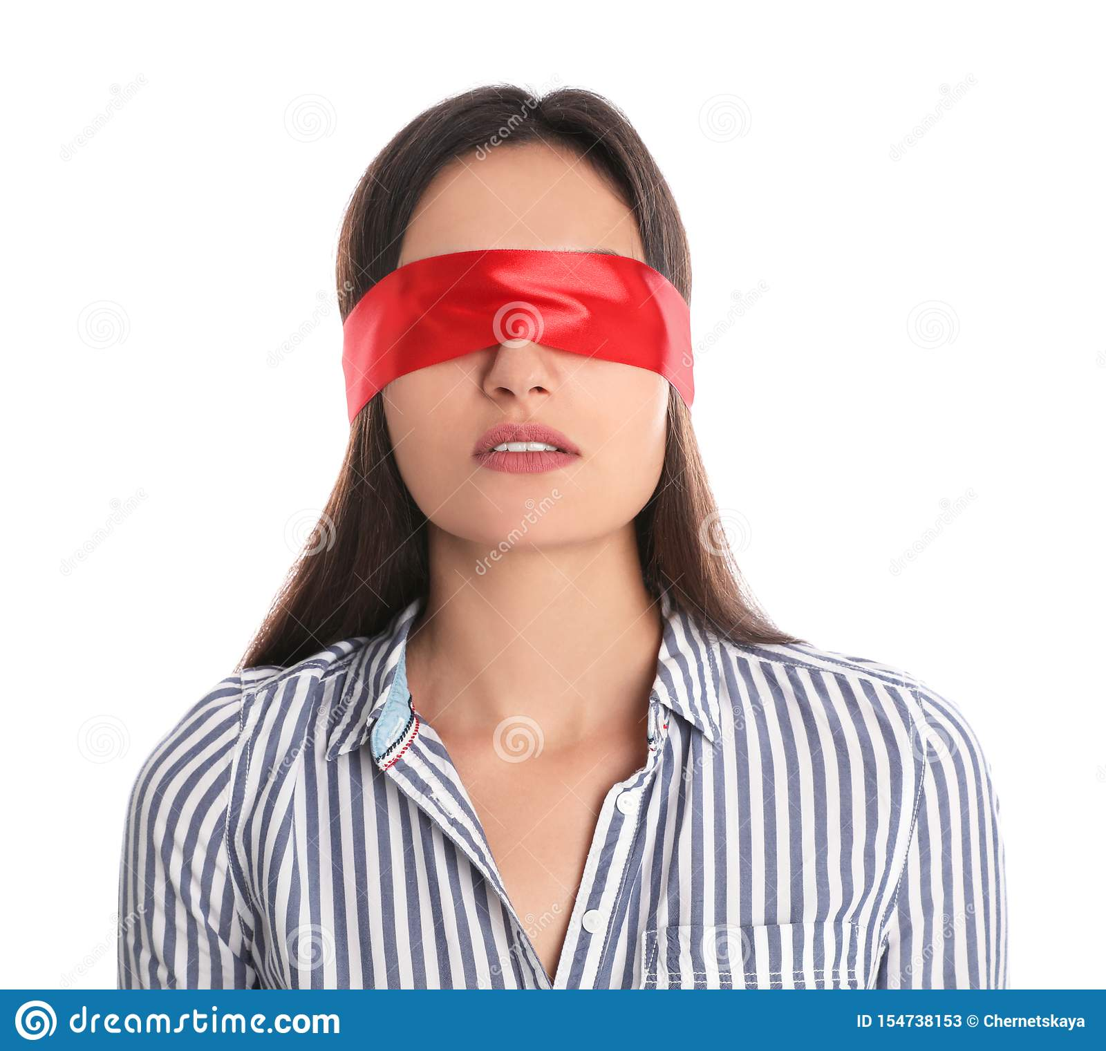 Young woman wearing red blindfold on white