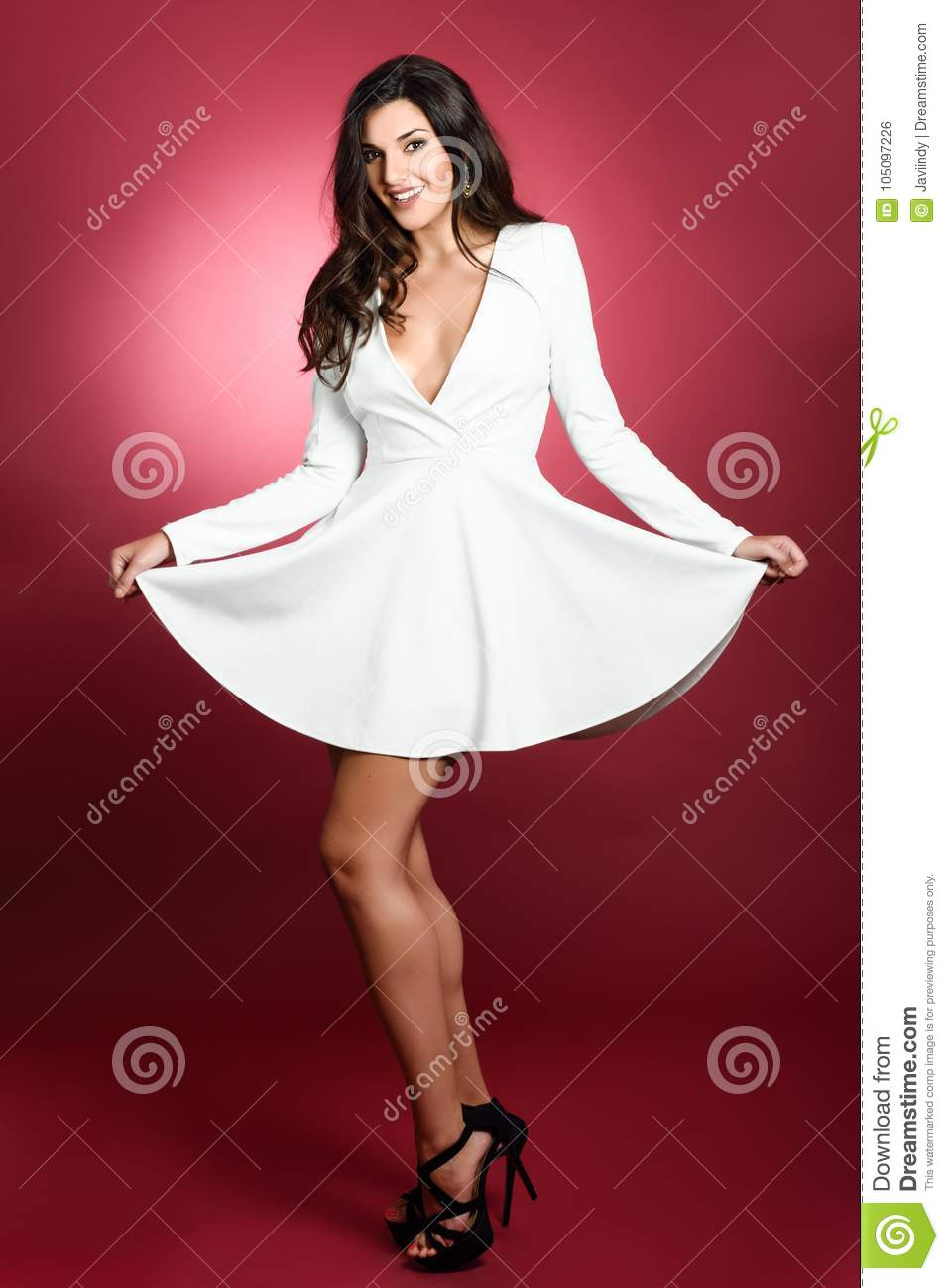 Young Woman Wearing Short White Dress Smiling To Camera ...