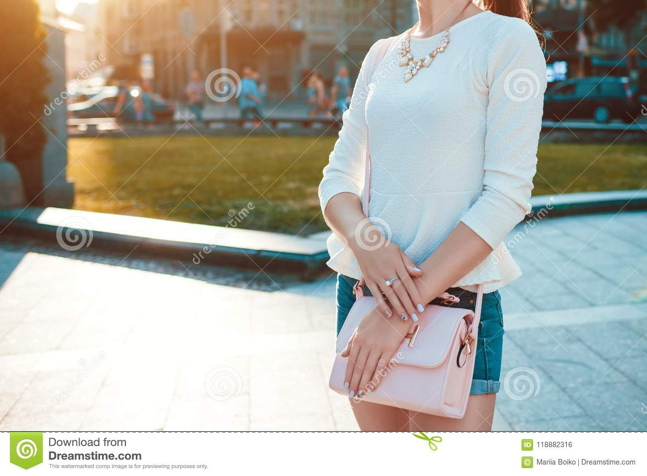 bc0ff178 Young woman wearing stlish outfit with accessories outdoors. Trendy female  handbag, clothing and jewellery. Beauty fashion concept