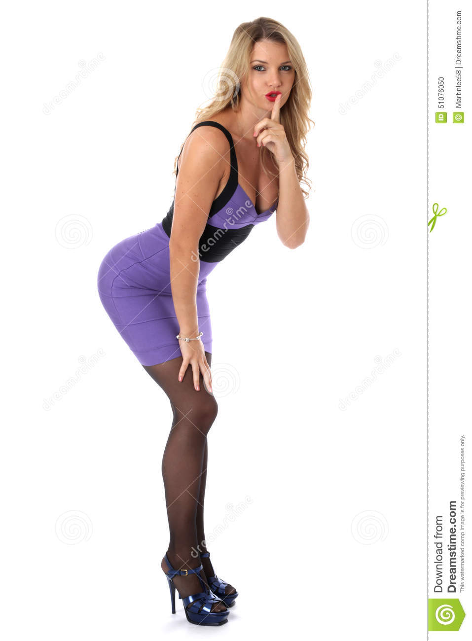 Young woman wearing tight purple short mini dress high heels stock