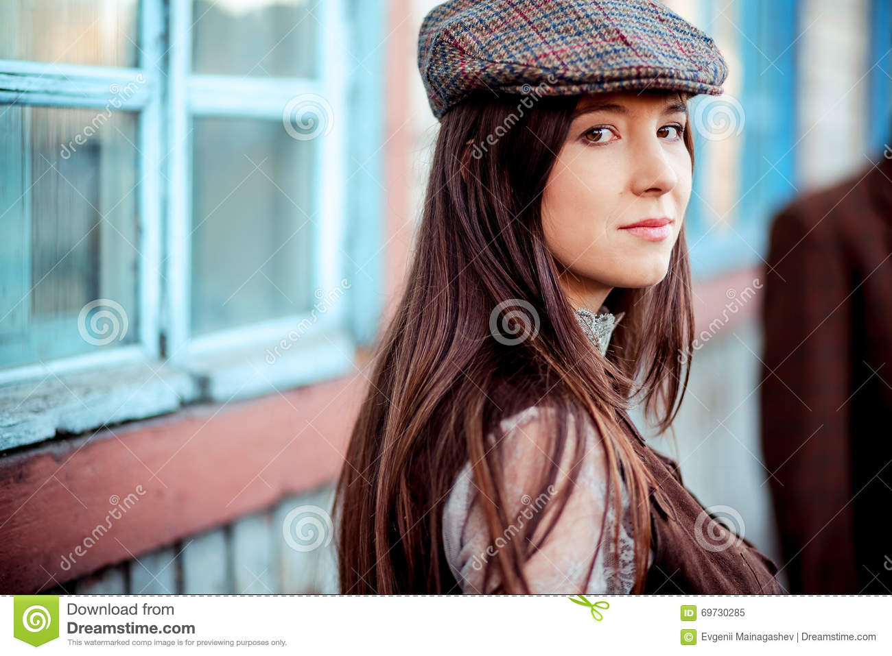 Young woman wearing tweed flat cap old fashioned portrait brown clothes. 626d4d53269