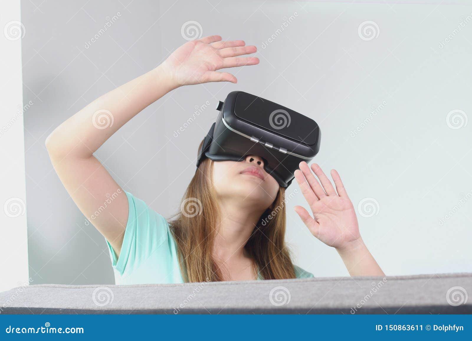 woman wearing virtual reality glasses by ReeldealHD