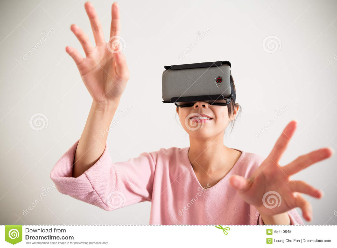 Young Woman wearing vr device and hand want to touch somrth
