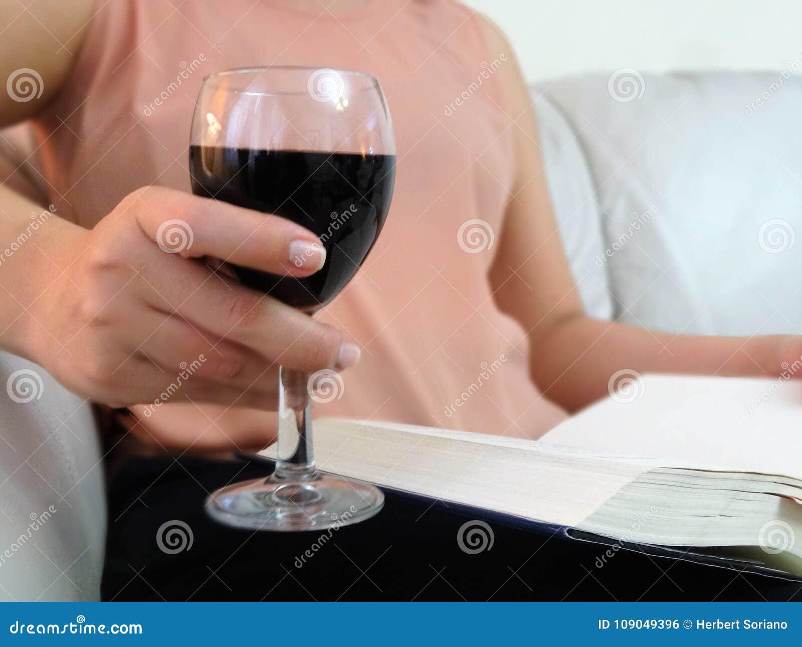 Super Young Woman Drinking A Cup Of Red Wine Reading A Book Stock Inzonedesignstudio Interior Chair Design Inzonedesignstudiocom