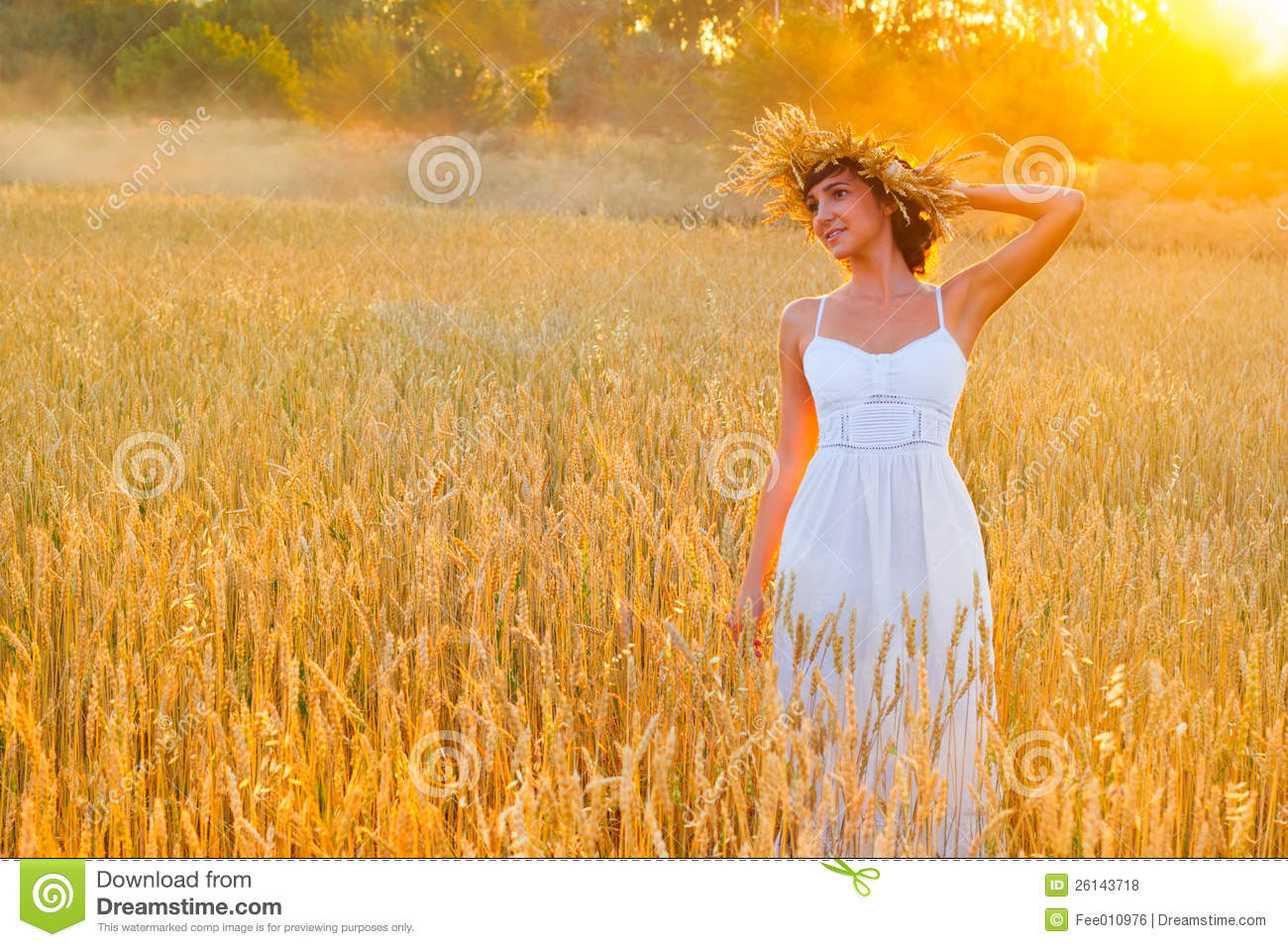 Young woman in white dress in field