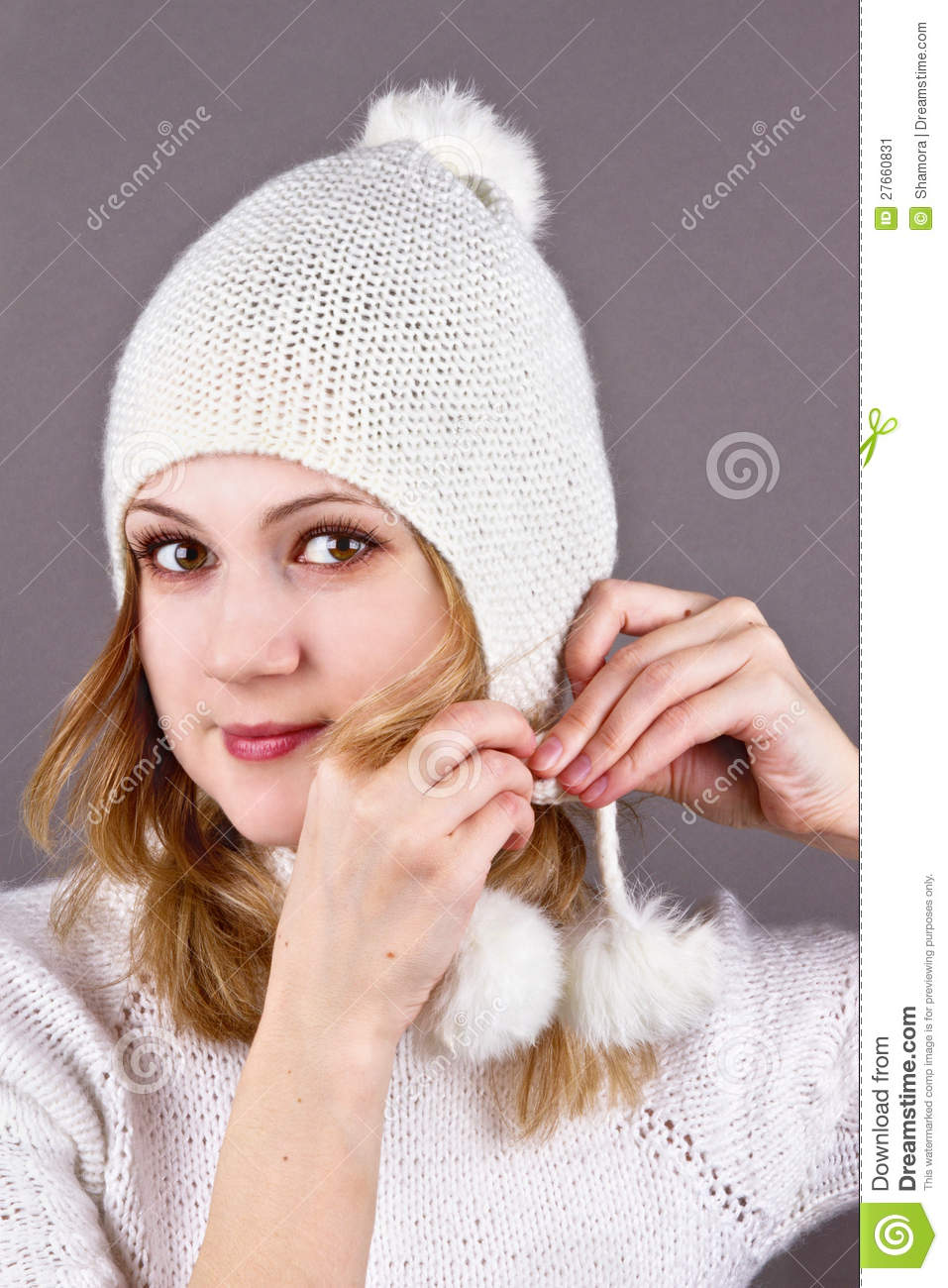 Young Woman In A White Knitted Cap Grey Stock Image ...