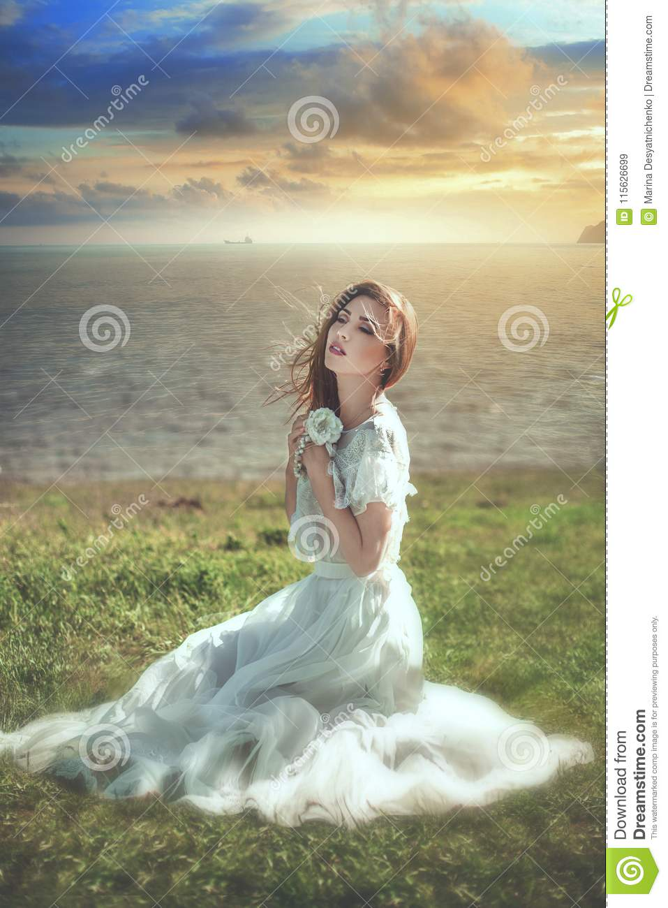 young woman sitting on the sea coast