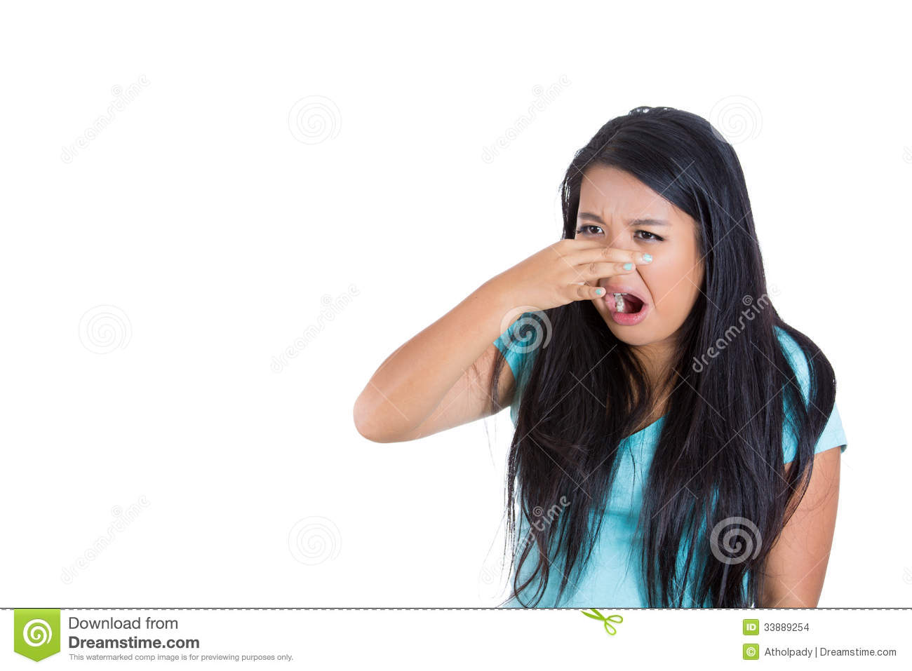 Young woman who covers her nose, looks away, something stinks, very bad smell, situation