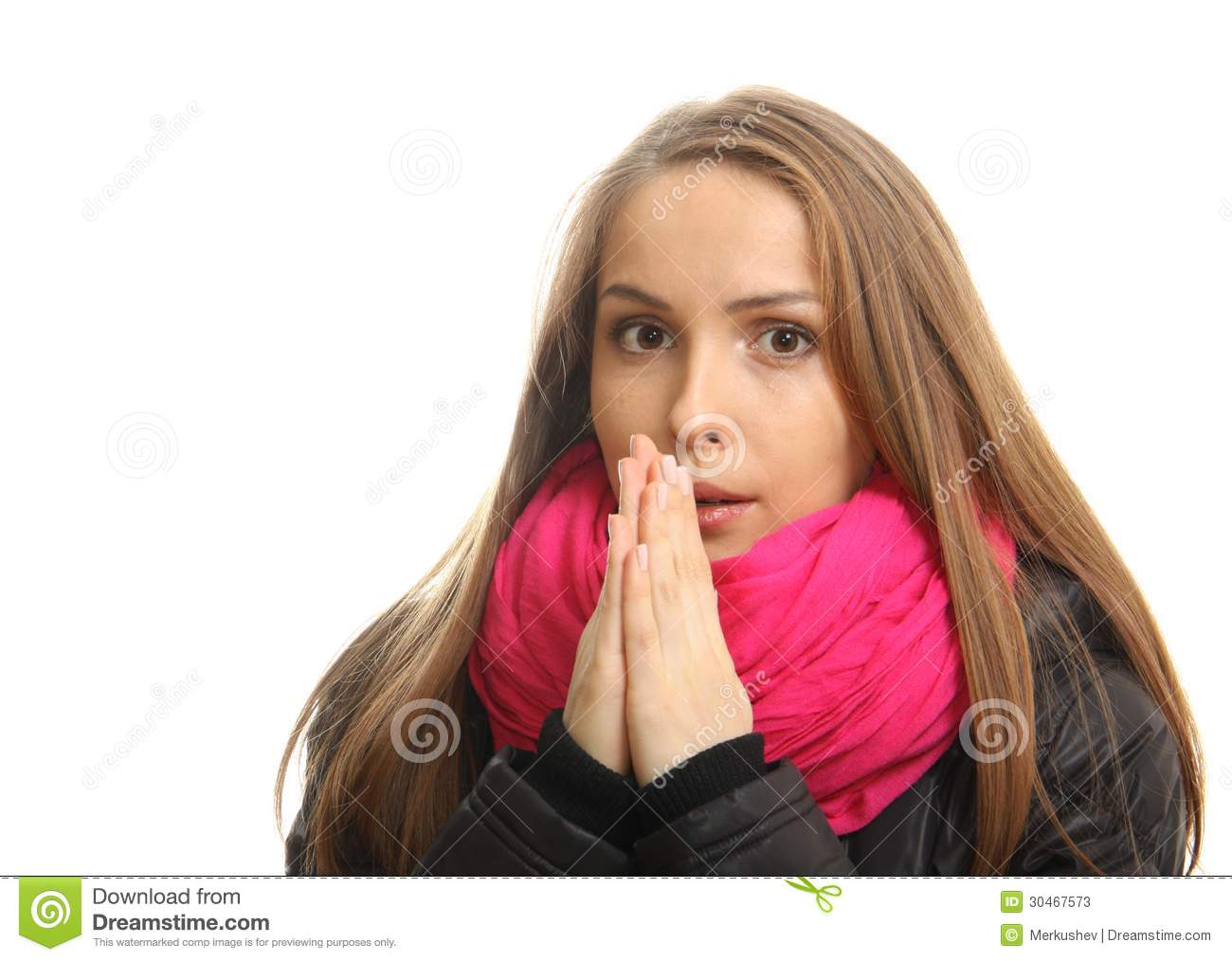 Young woman in winter tries to warm up her hands