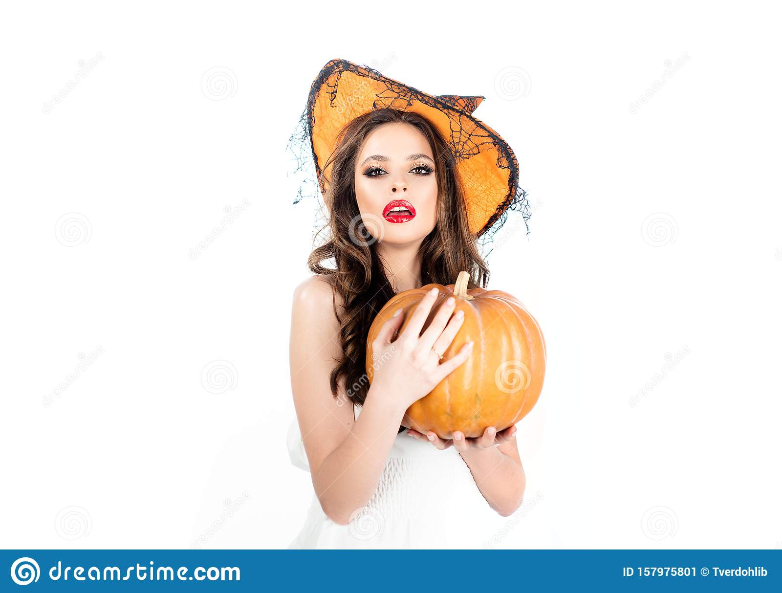 Young woman with witch hat dressed as vampire for Halloween party - isolated on white background. Vampire woman on