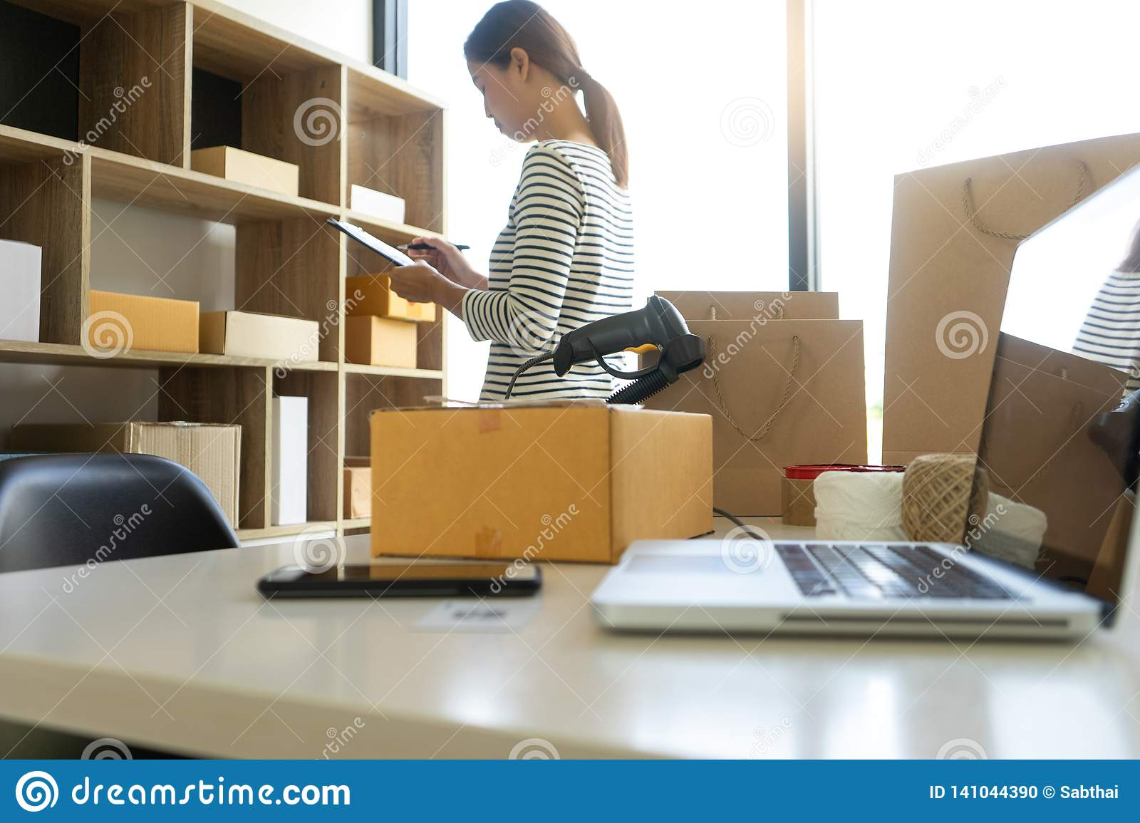 young woman work in back office