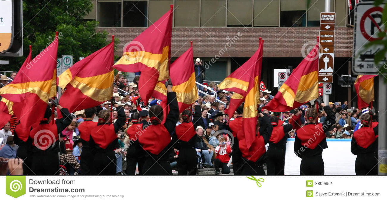 Young Women Carrying Flags In Parade Editorial Photography