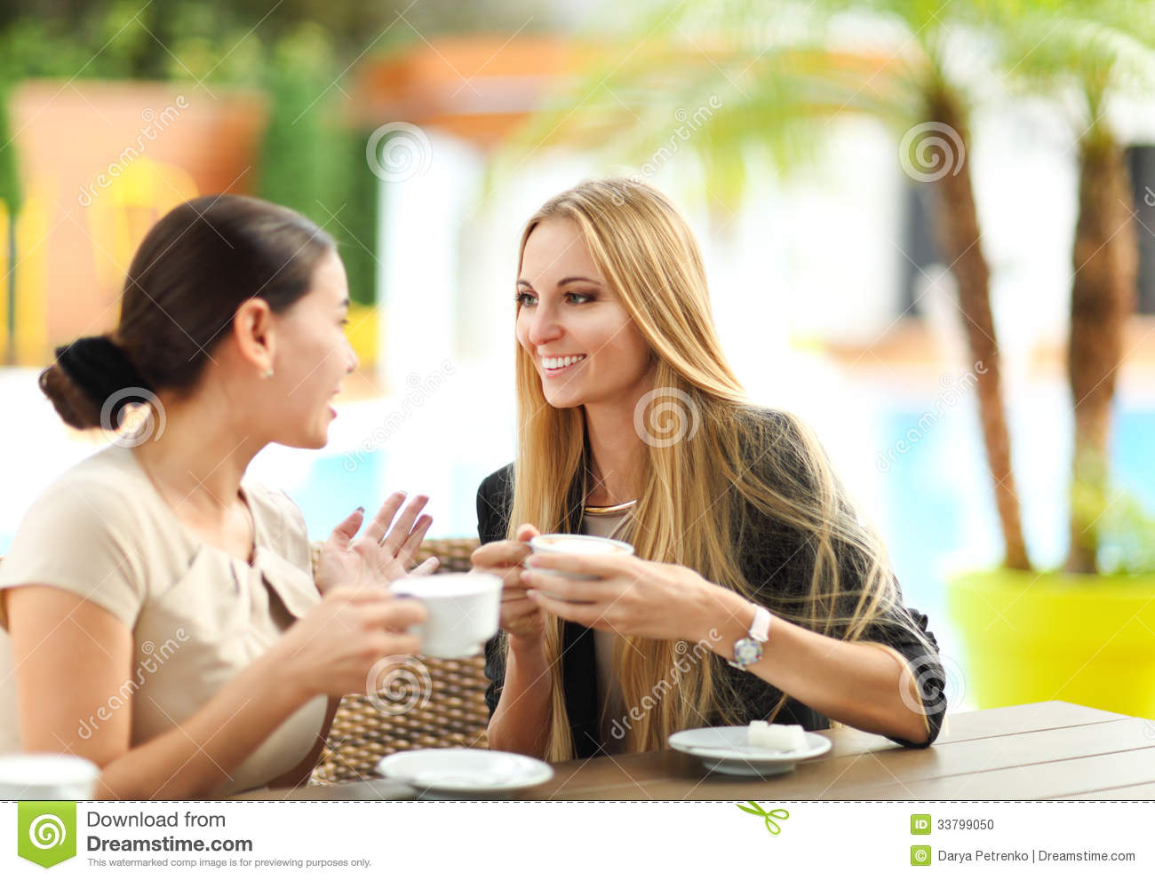 Young Women Drinking Coffee In A Cafe Outdoors Stock Photo ...