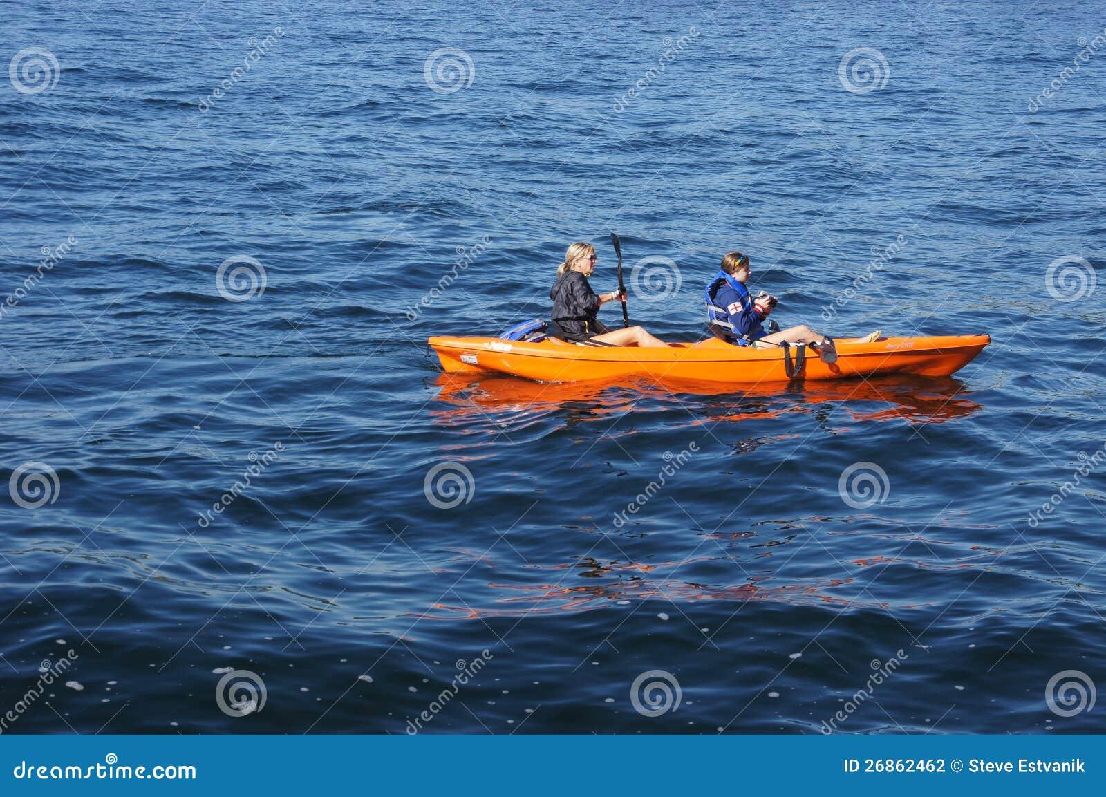 naked women in canoe