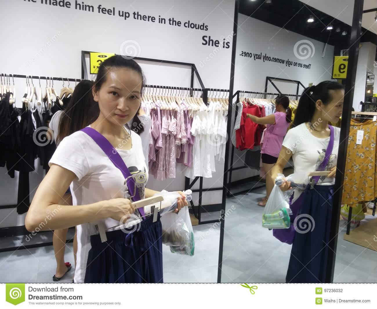 5c22dae27812b Young women are shopping for clothes during the night at the clothing store