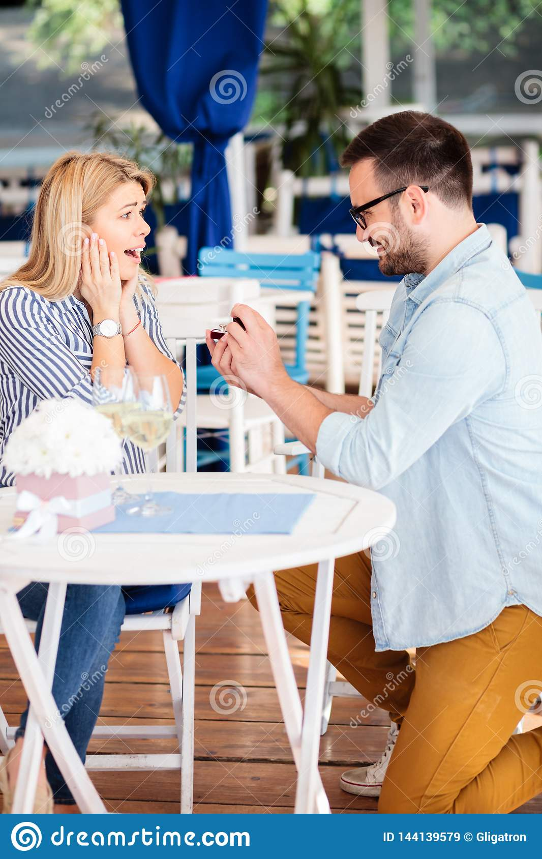 Surprised and very happy young woman after being proposed by her boyfriend