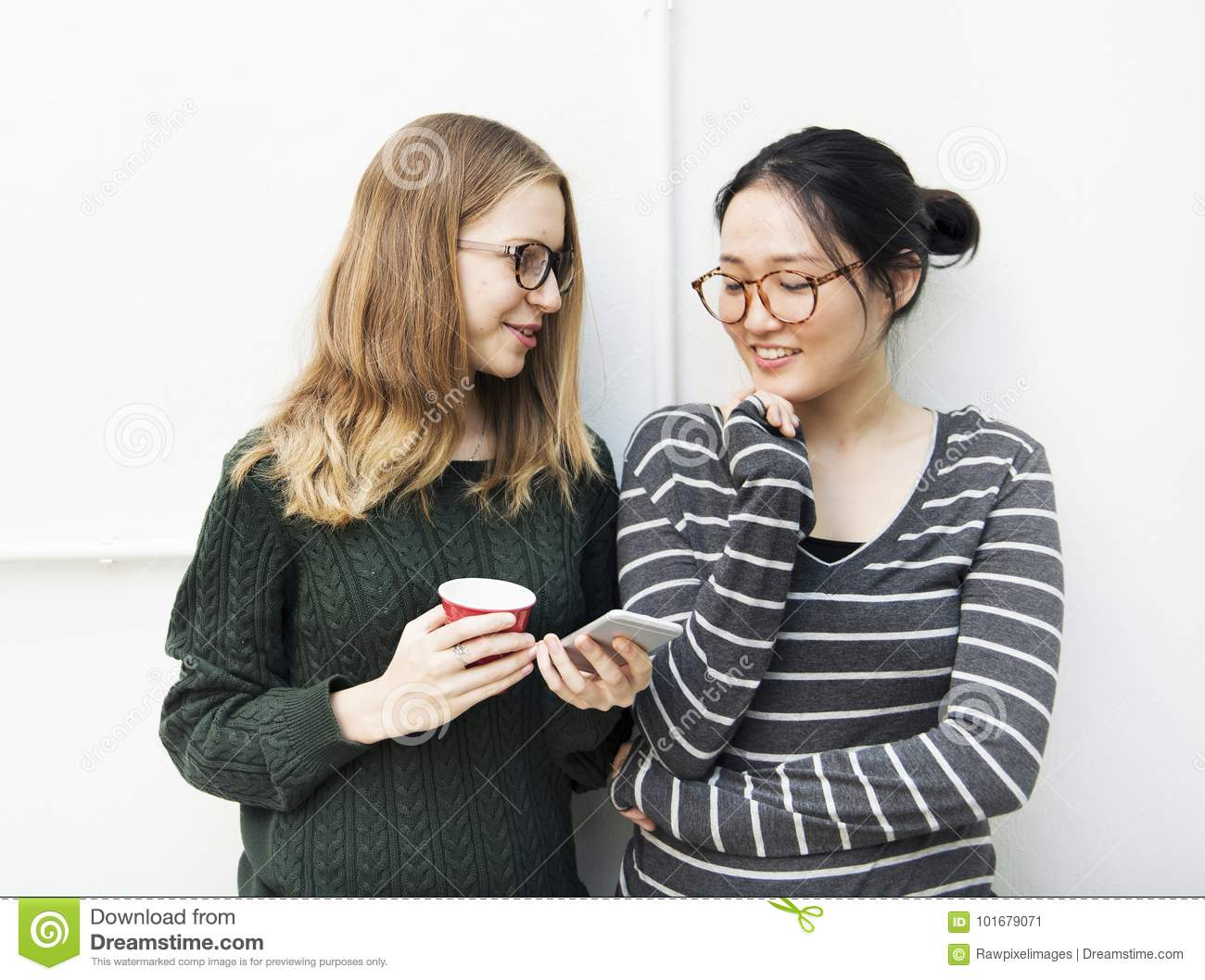 Young women are using mobile phone