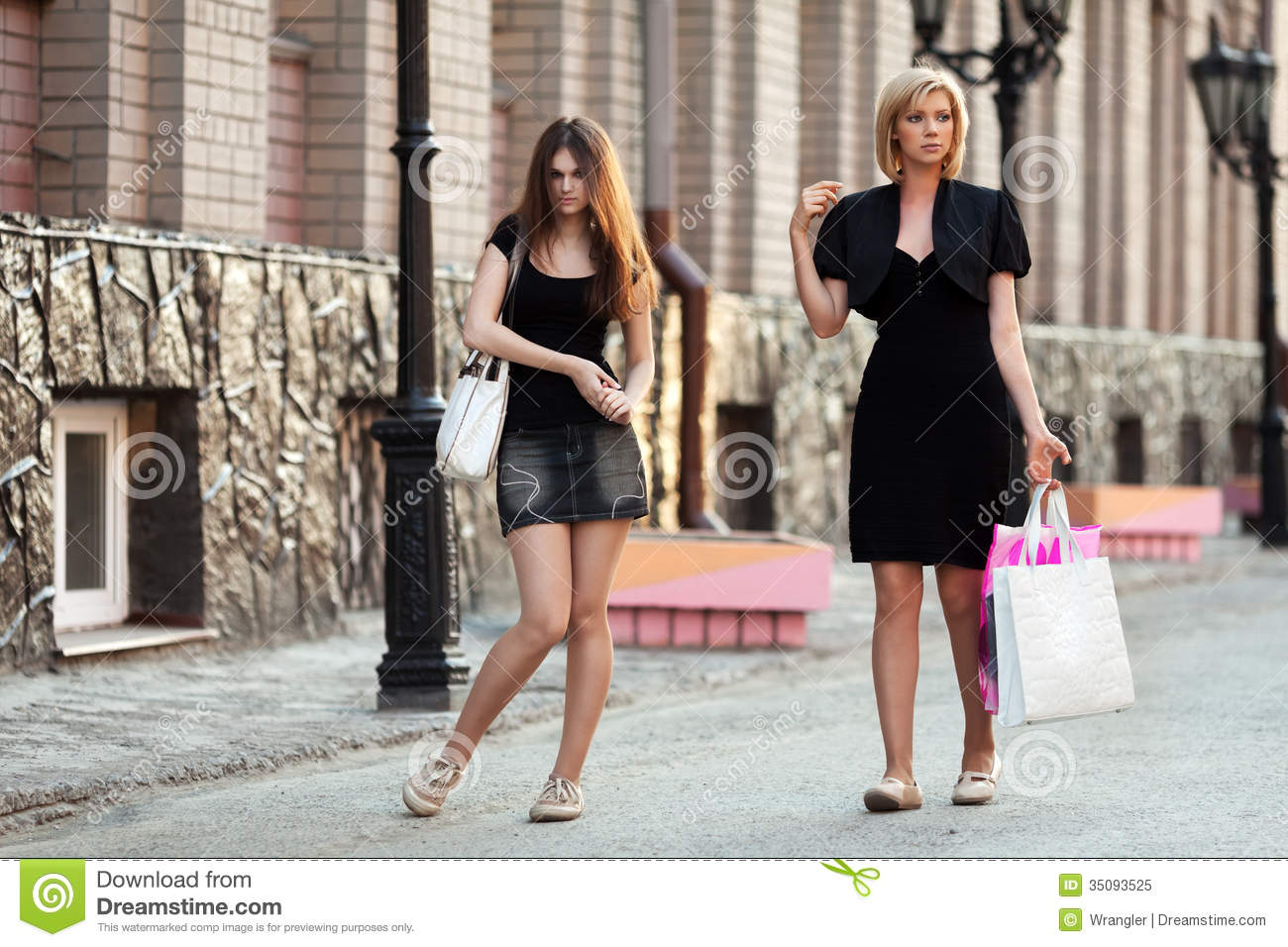 Young woman walking city young women walking on a city street royalty