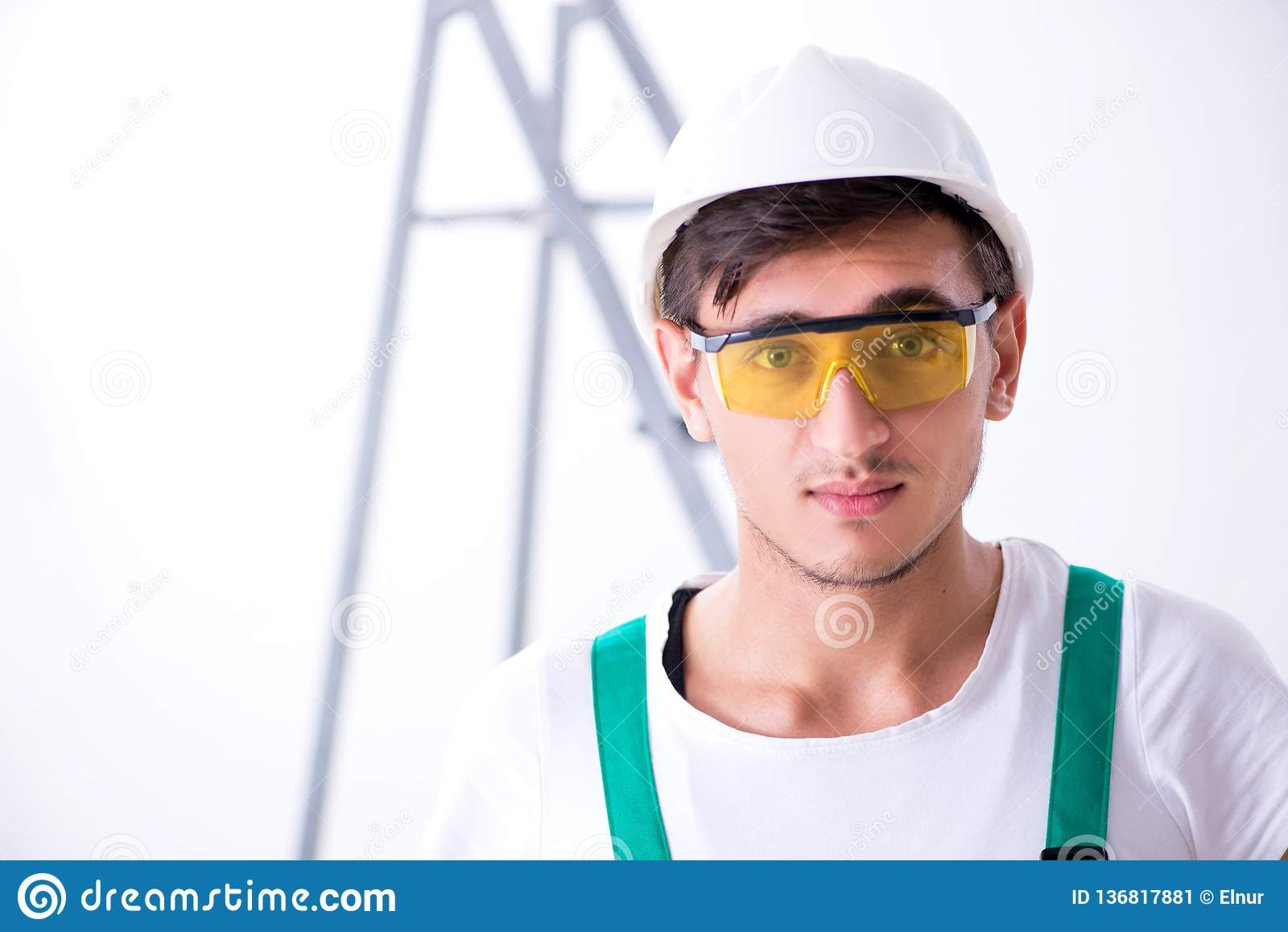 The young worker with protective equipment in safety concept