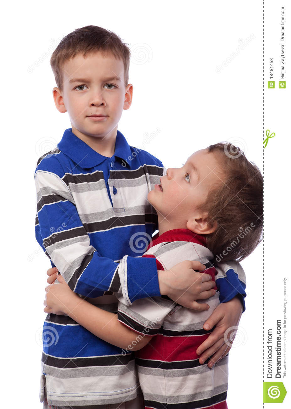 Younger Brother Looks At His Big Brother Royalty Free