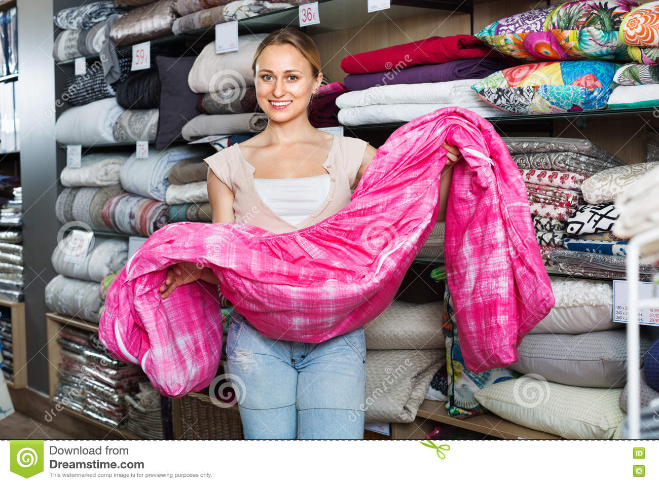 Youngwoman Buying Bed Spread In Textile Store Stock Image