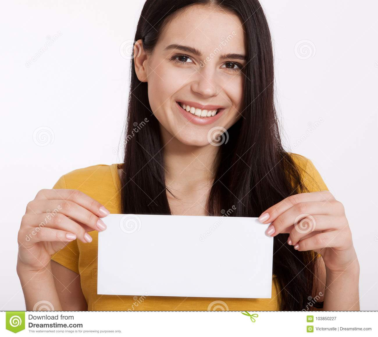 Your text here. Pretty young woman holding empty blank board. Studio portrait on white background. Mockup for design