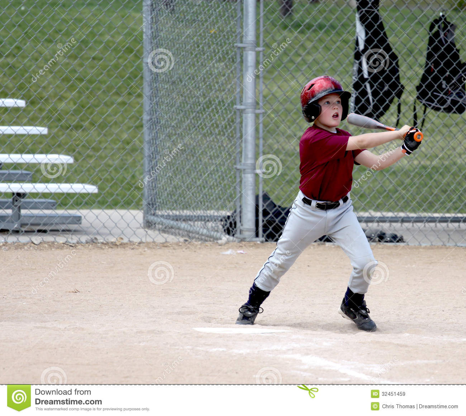 youth baseball player at bat stock image