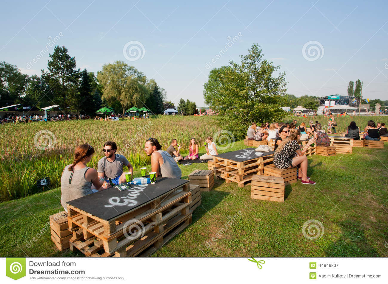 Youth Have Fun With Friends And Drinks On Outdoor Party