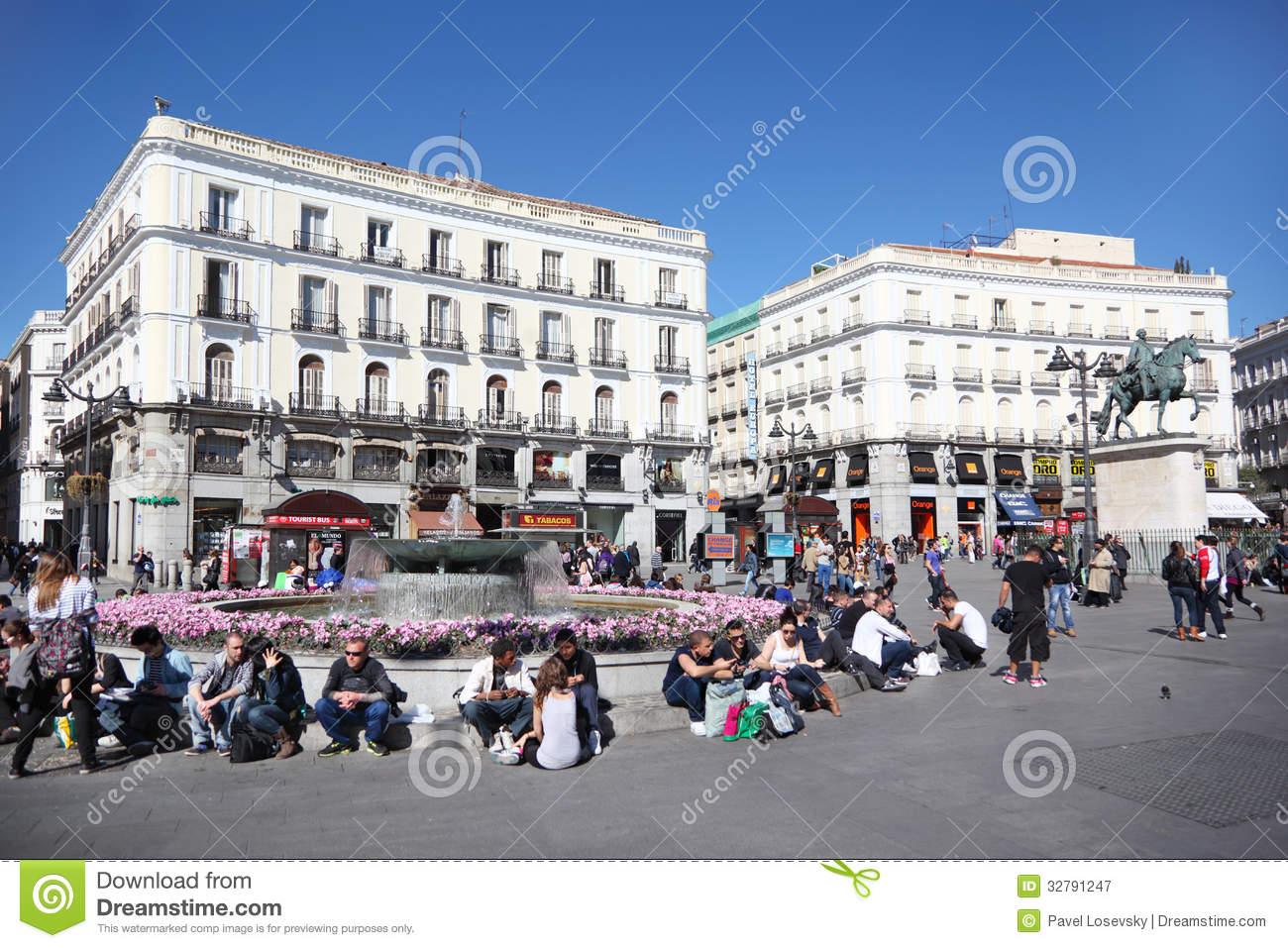 Youth at puerta del sol near monument editorial for Puerta del sol 9 madrid