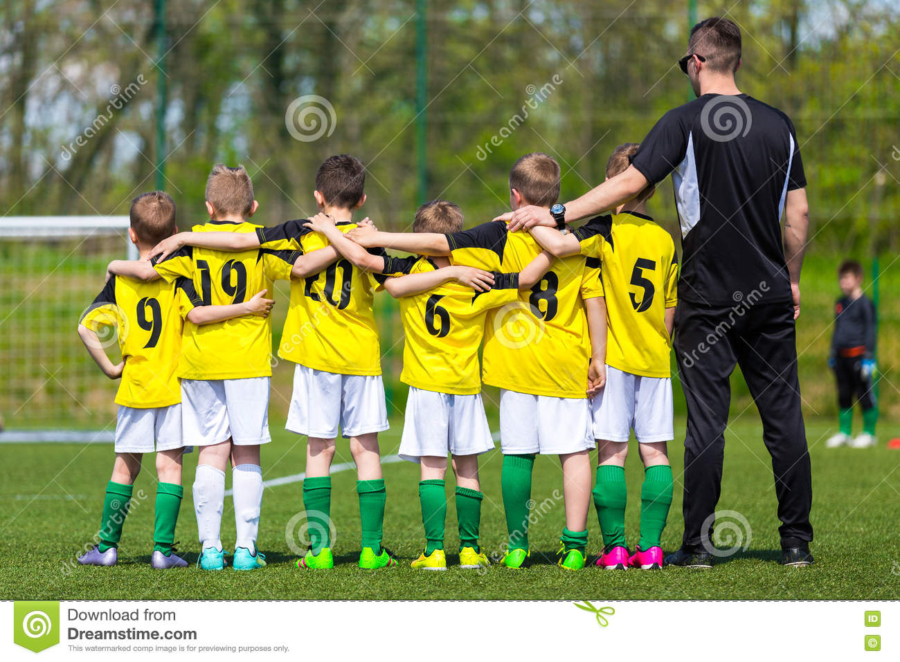 Youth Soccer Team With Coach  Young Football Team On The