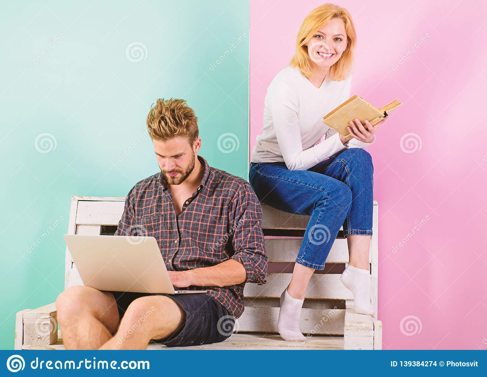 Youth spend leisure preparing for entrance exam. Couple students with book and laptop studying. Man and woman use