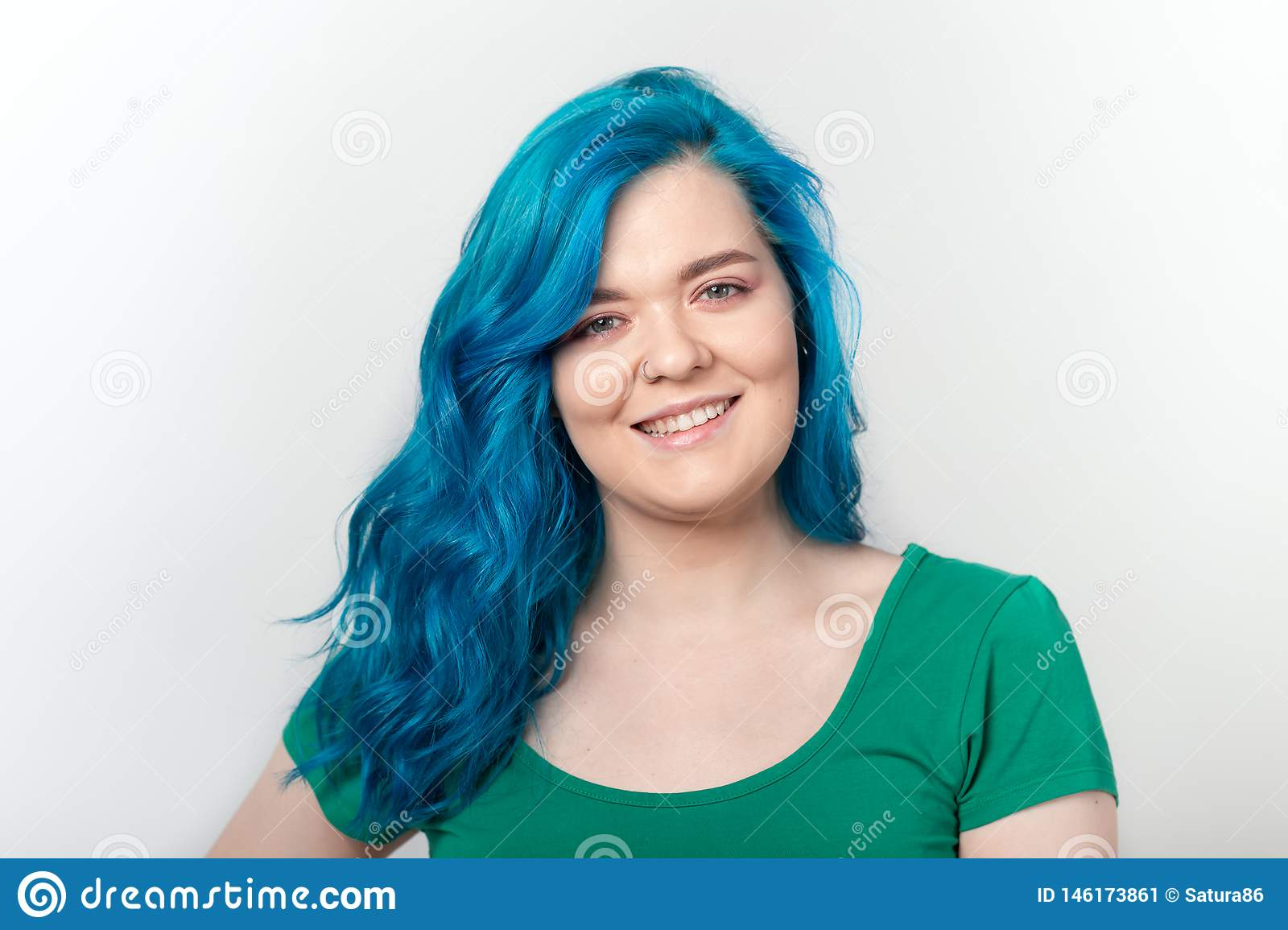 Youth, stylish and fashion concept - Young beautiful woman with blue hair is smiling over white background