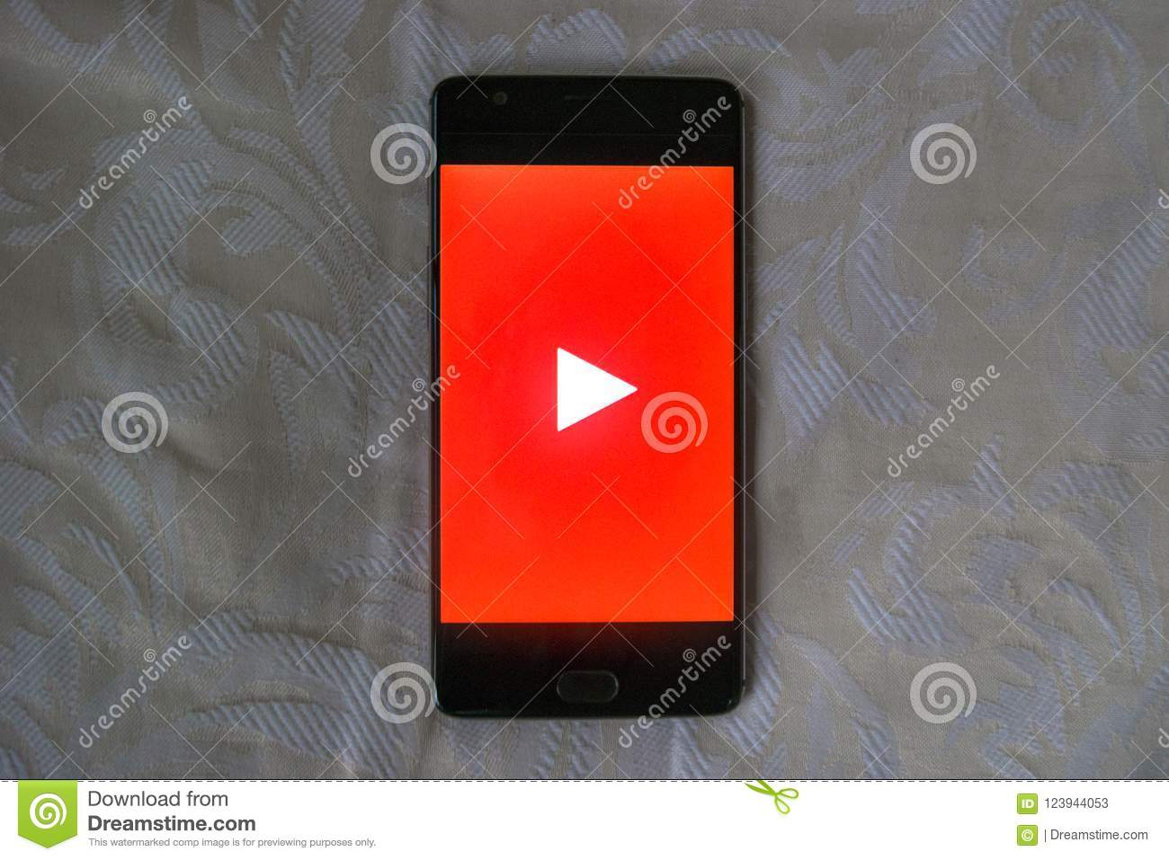 Youtube App On An Android Phone With White Texture Background