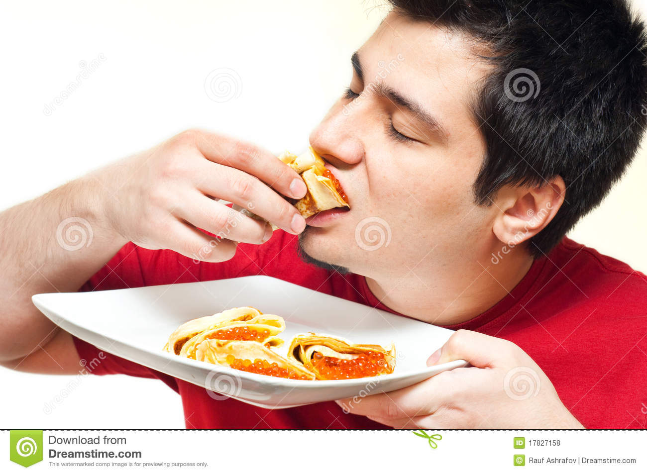 Youung Man Eating Pancakes With Caviar Royalty Free Stock ...