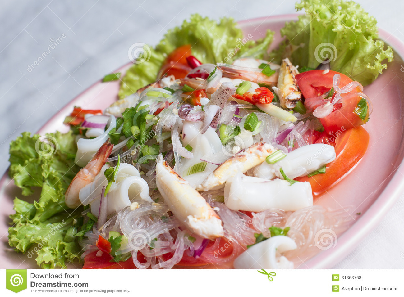 Cellophane noodle Spicy salad with seafood on pink plate.