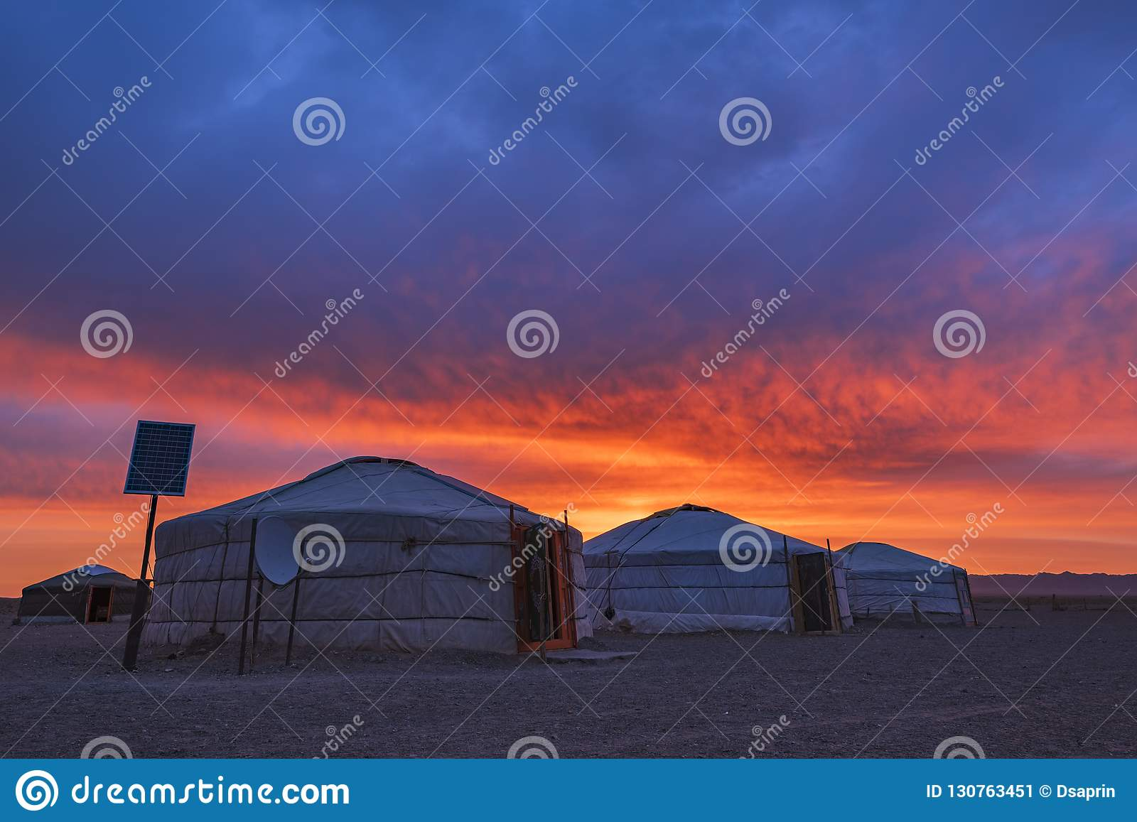 Early Morning View of Traditional Yurt mongolian family in Mongolia landscape Gobi Desert at sunrise.