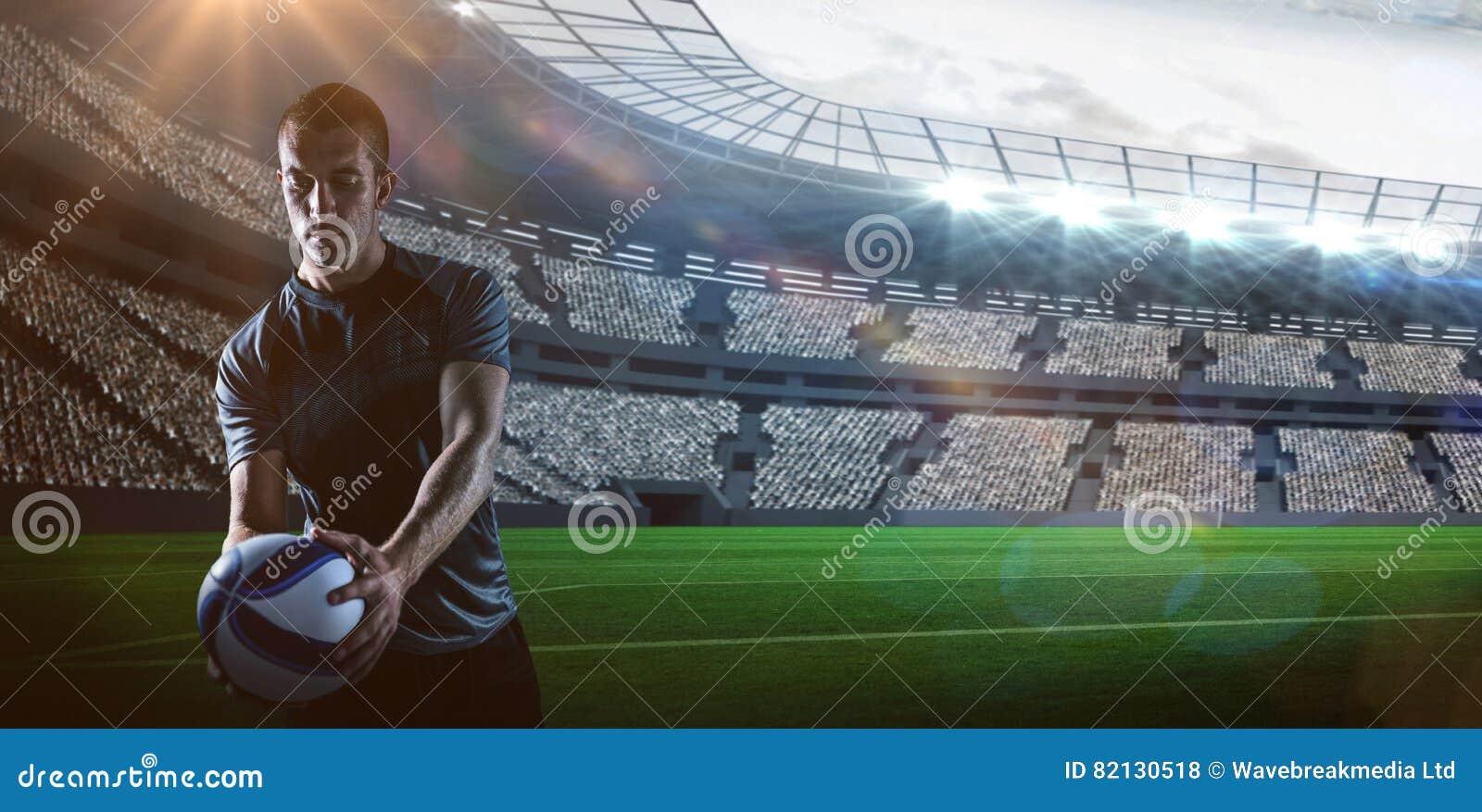 Złożony wizerunek przystojna rugby gracza mienia piłka