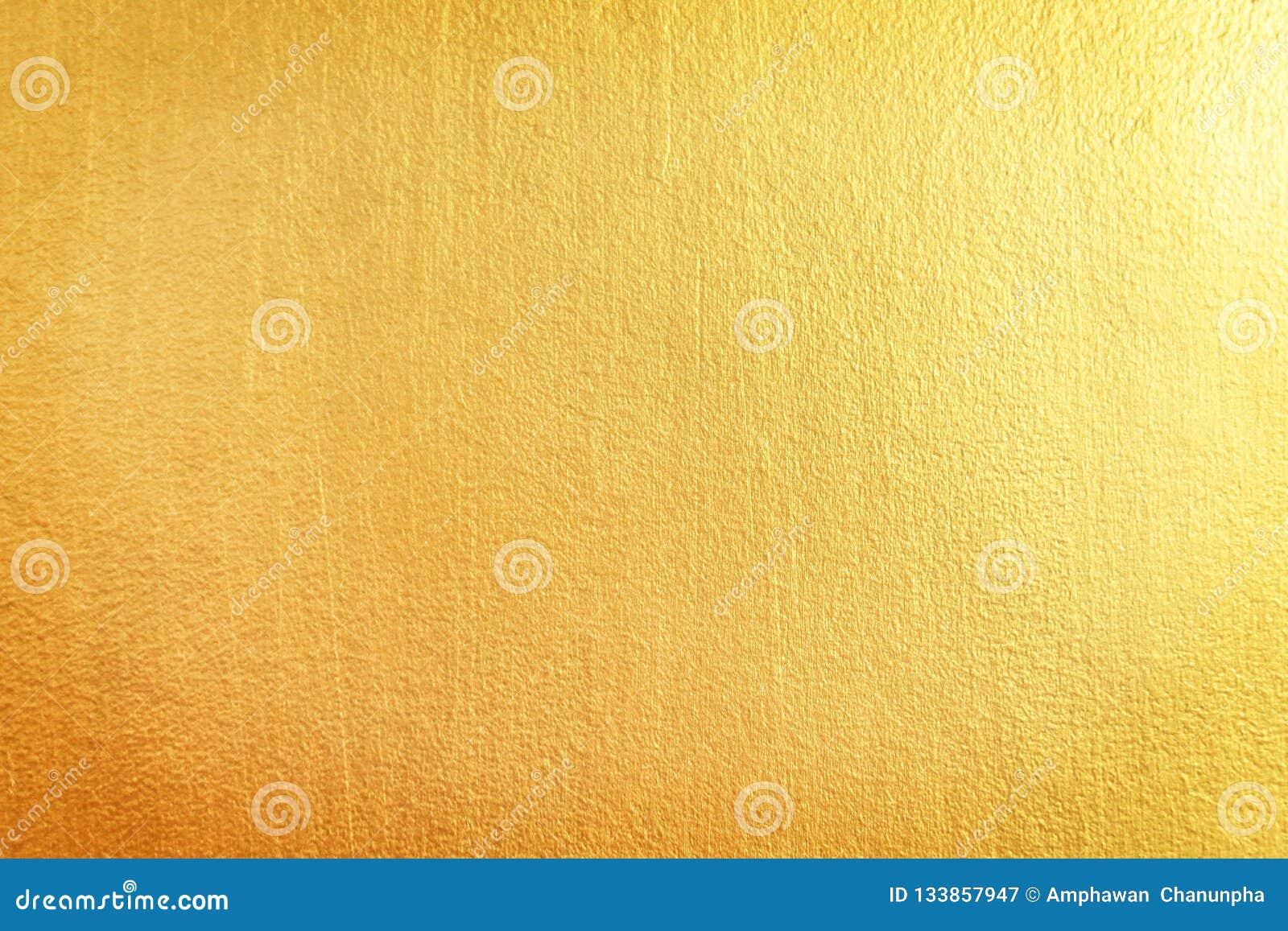 Złocista betonowa ściana deseniuje tekstura abstrakta tło