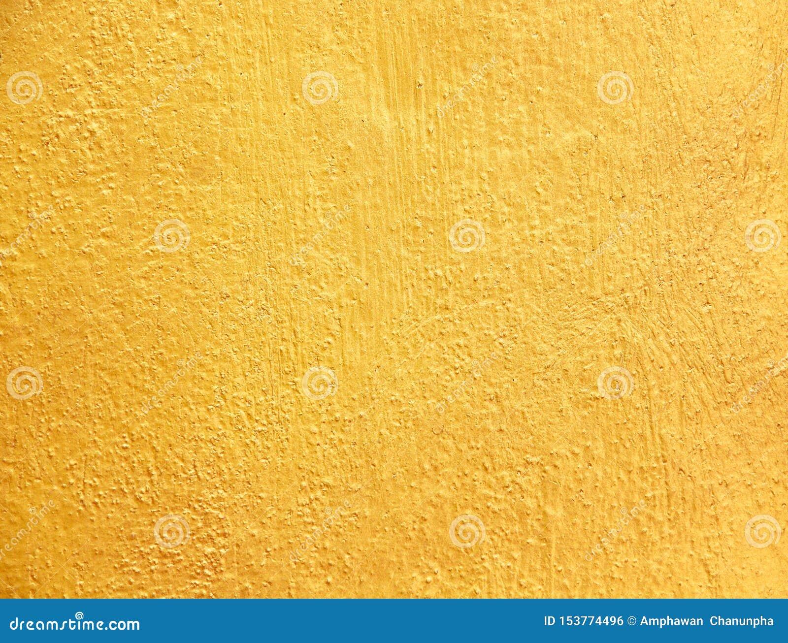 Złocistej betonowej ściany abstrakcjonistycznej starej tekstury szorstcy wzory dla tła